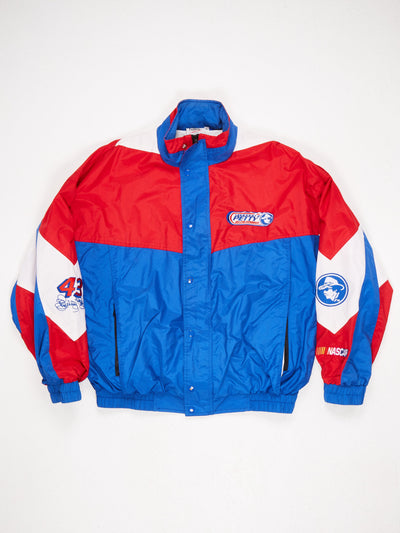 Lightweight Nylon Jacket Zip Fastening with Poppered Overlay 'Richard Petty Driving Experience' Patch on the Front and Back Multiple Patches on Sleeves Blue / Red / White Size XL