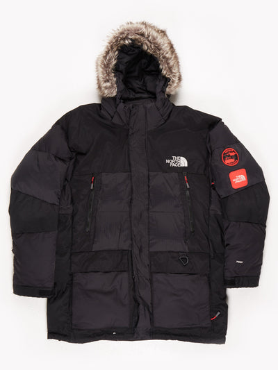 The North Face Padded Parka Faux Fur Trimmed Hood Multiple Poclets and Patches on the Sleeve Black Size XL