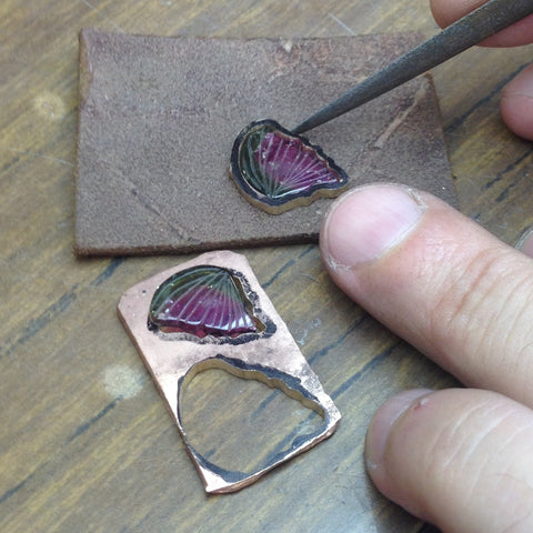 Close up on a goldsmith working on a new tourmaline Butterfly jewel