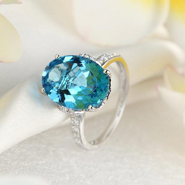 14K White Gold 6.5 Ct Oval Swiss Blue Topaz 0.22 Ct Natural Diamond