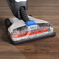 A hard floor cleaner washing hardwood floors
