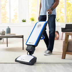 Silver and blue HEPA upright vacuum that works on carpet and hard floor
