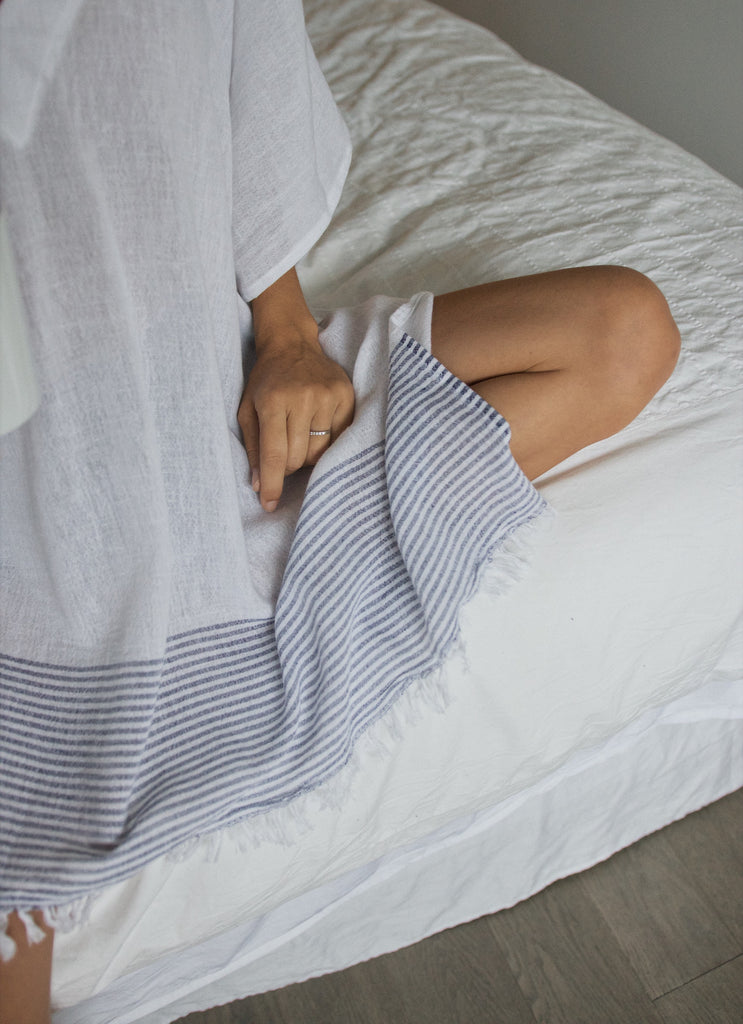 Woman Resting on Bedside
