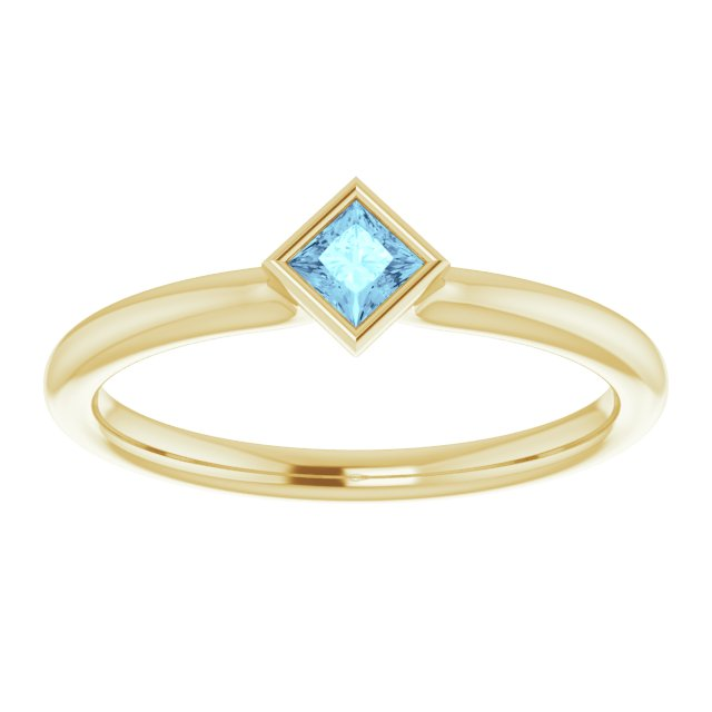 Aquamarine bezel set yellow gold ring