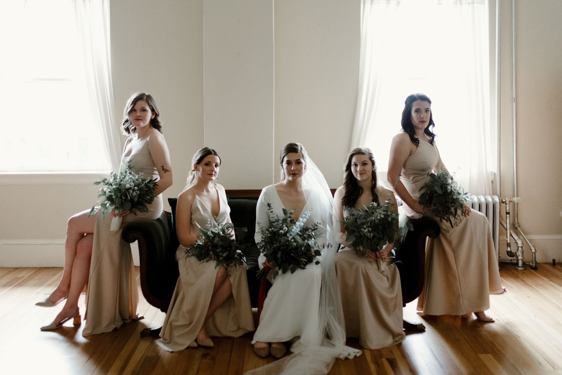 bridesmaids in satin dresses with bride