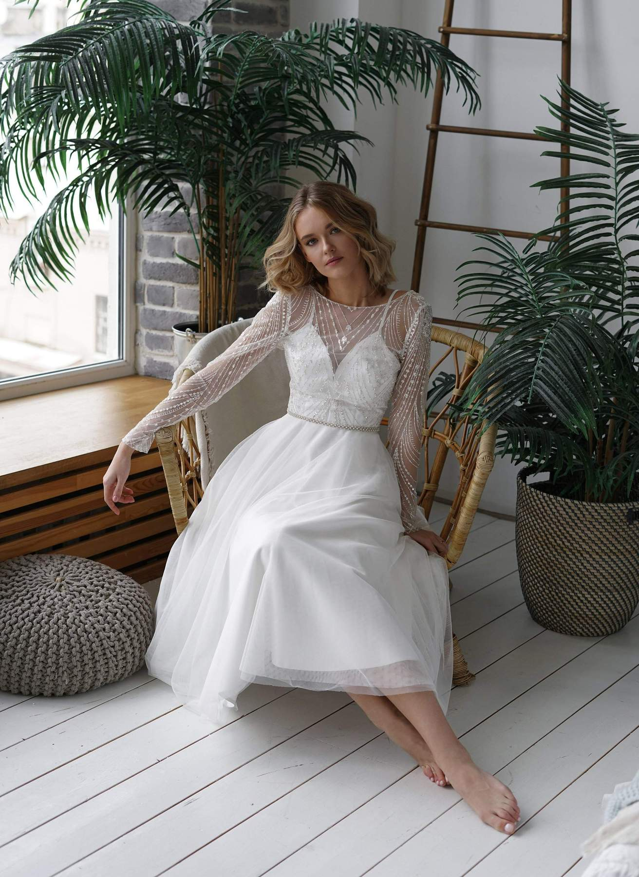 model in a short wedding dress with sleeves