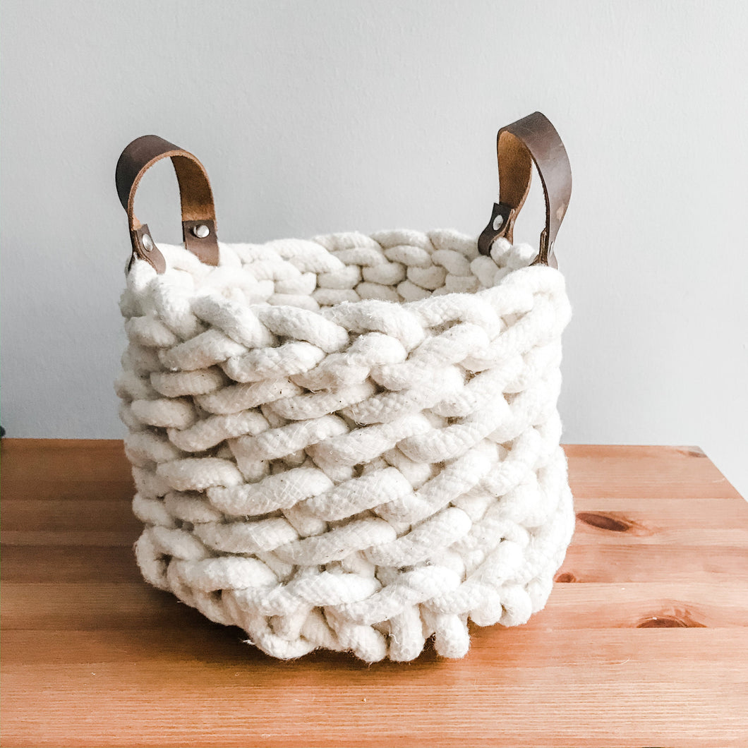 Crocheted rope basket with leather handles
