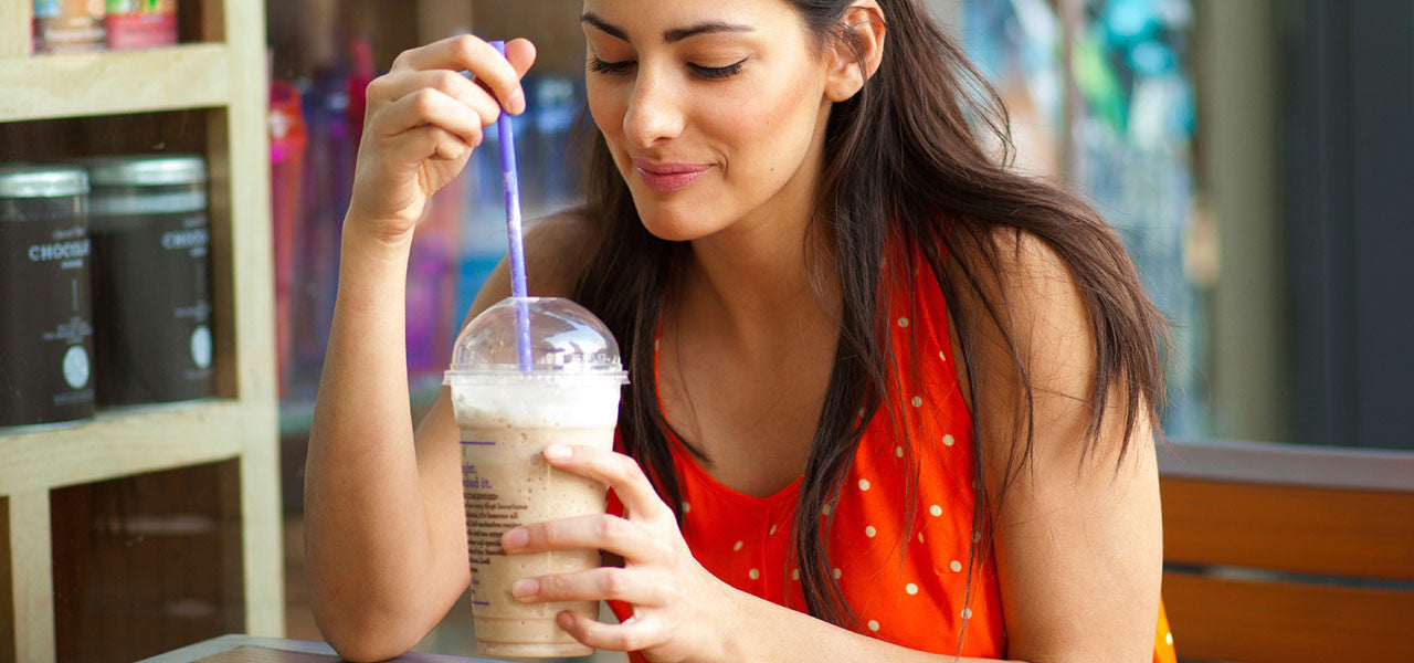 woman drinking frappe