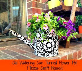 Old Watering Can Turned Flower Pot