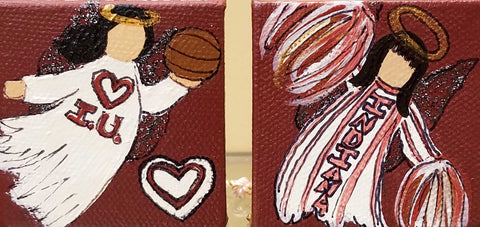 "Set of 2 IU angel ornaments, one with a basketball and another cheerleader. Indiana is written on the side of the ornaments.  Artist: Amanda W. Mathis Medium: Acrylic Size: 2"" x 2"" each 