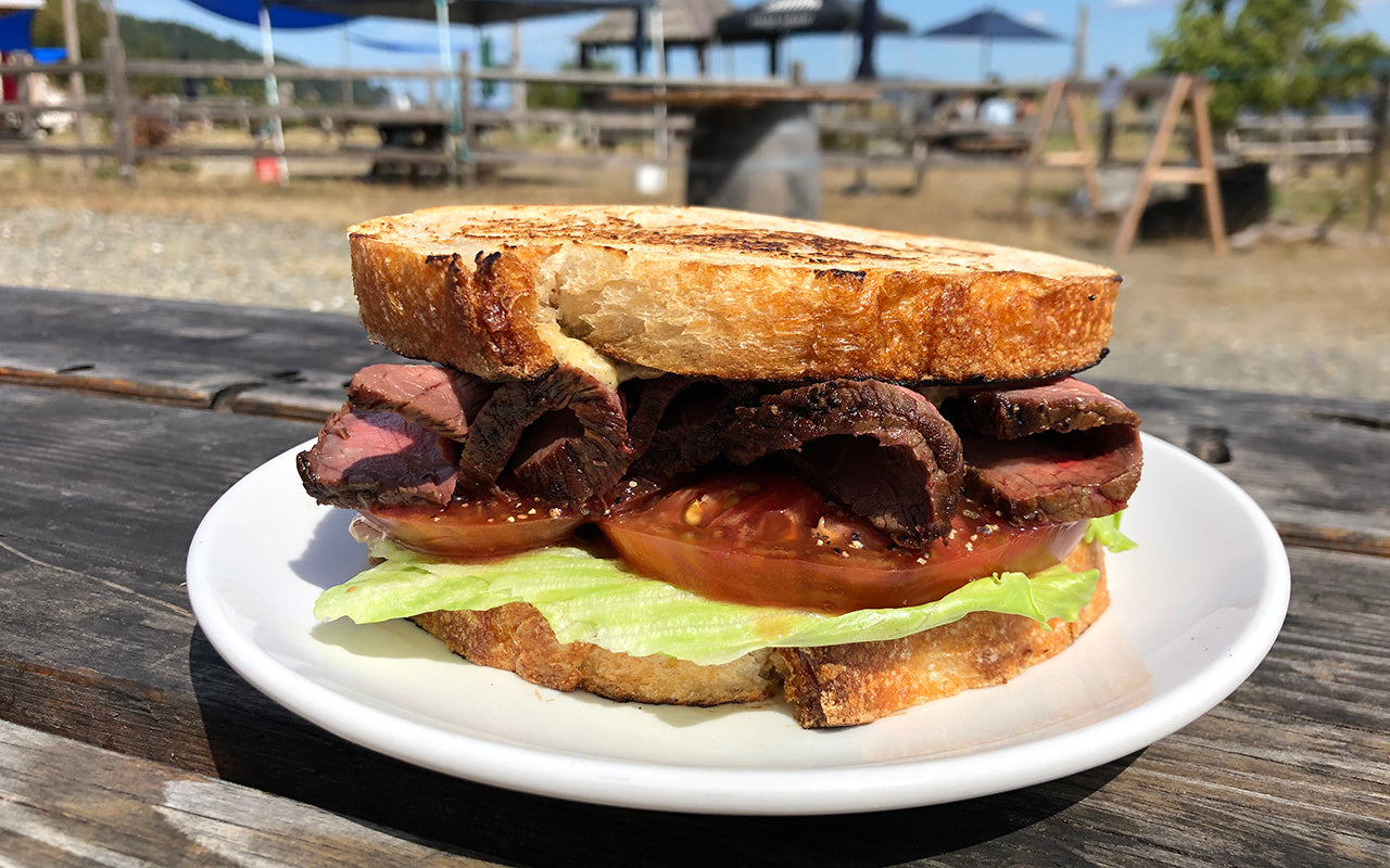 Oyster Rancher's Sandwich has roast beef, lettuce, tomato and a smoked oyster mayo