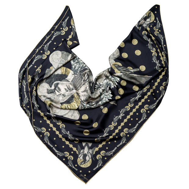 streetart-silk-scarf-paris-by-mocomoco-berlin-artist-madame-moustache-motif-collage-with-heads-of-women-black-gold-140x140cm-elegantly-folded in-bird-wing-shape