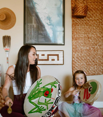 Indigenous woman connecting with culture and ceremony as a act of resilience and reconciliation. Indigenous woman increasing funding opportunities to First Nation, Metis and Inuit peoples.
