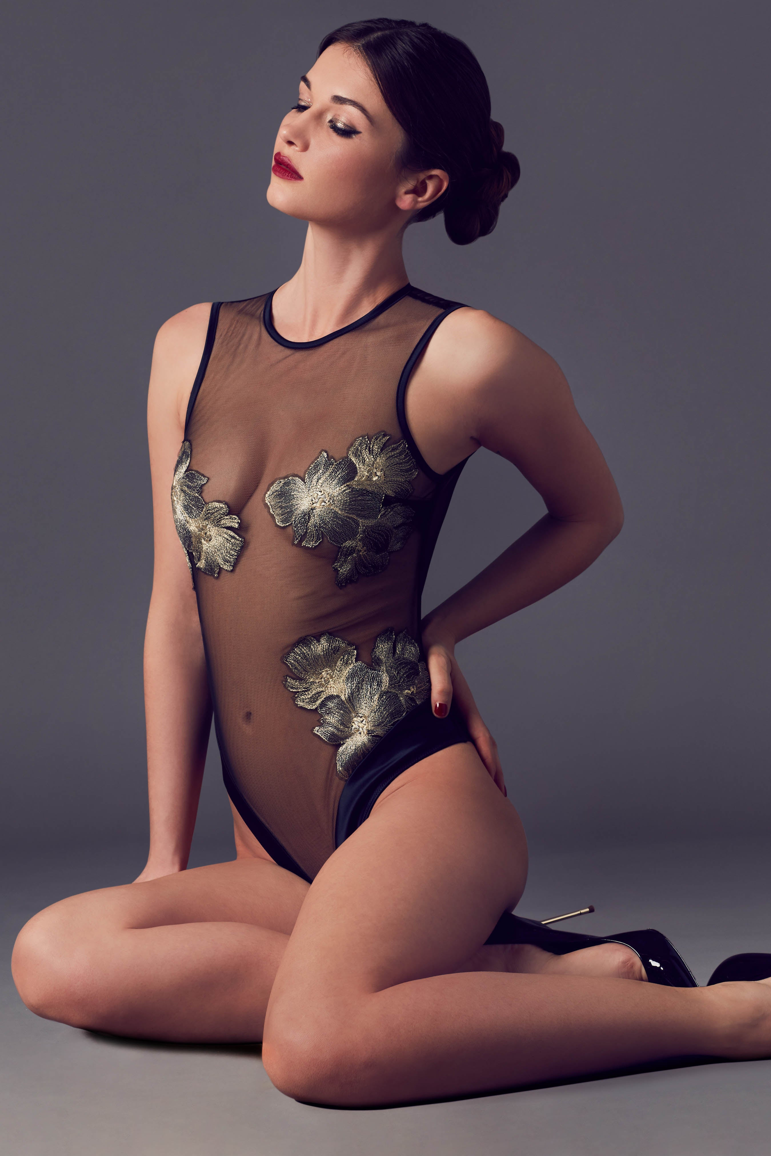 Ayako luxury sheer bodysuit in black and gold, with metallic floral embroidery