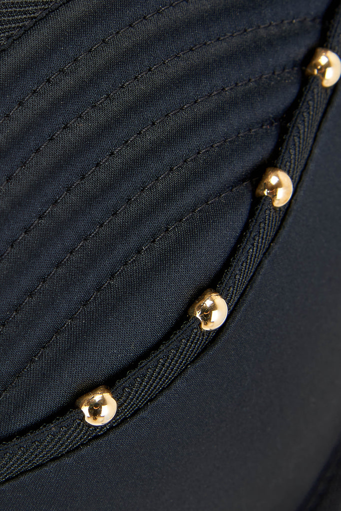 Close up details of gold studding on the Babooshka suspender thong