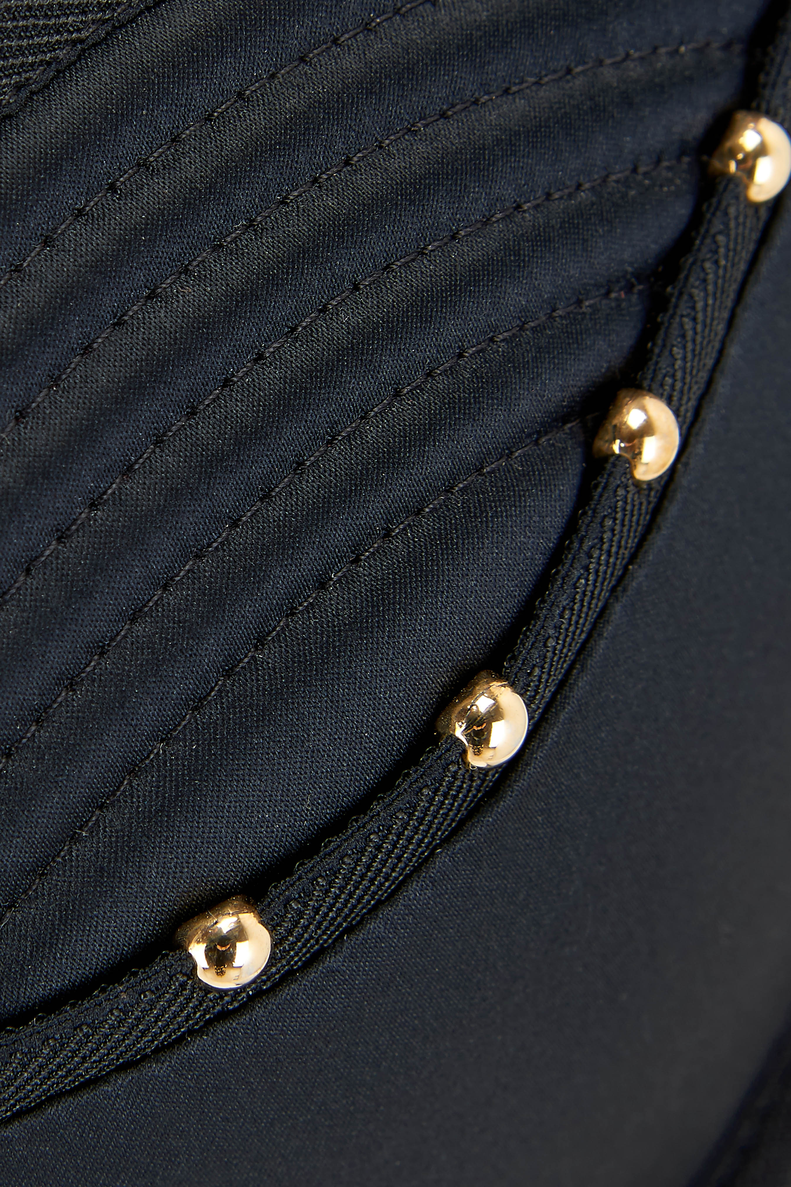 Close up details of gold studding and quilting on the Babooshka suspender