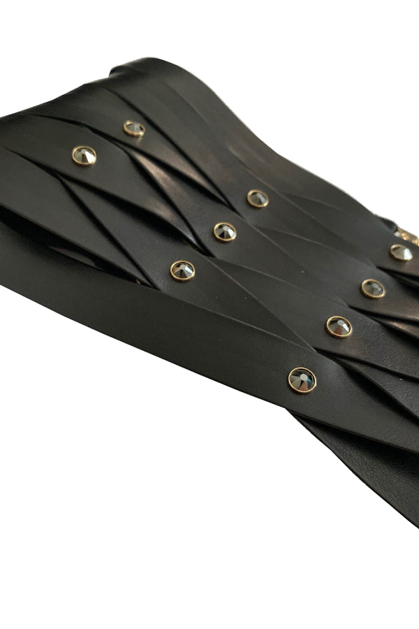 Designer corset belt crafted from vegan leather and Swarovski rivets