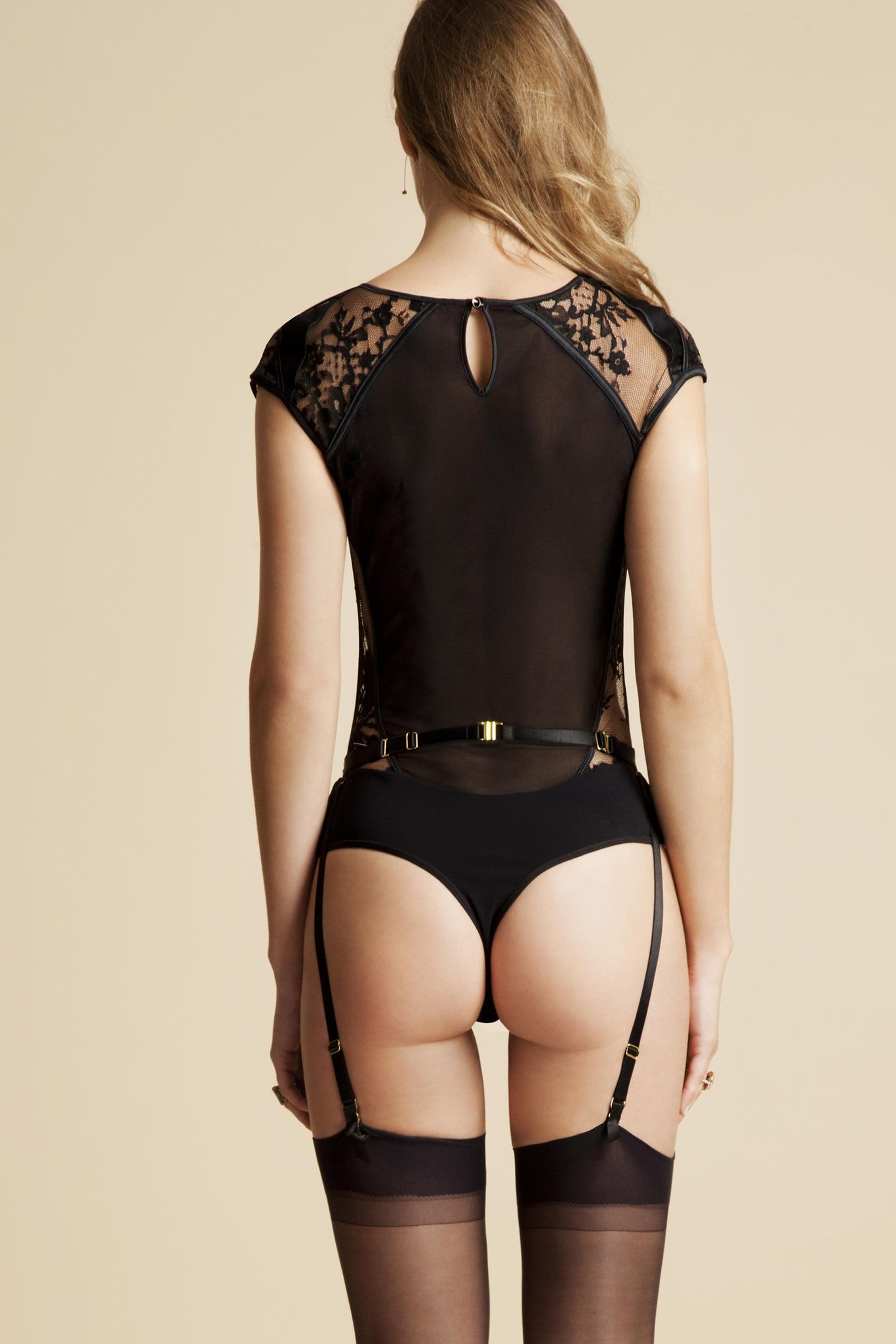 Luxury lace bodysuit featuring thong back