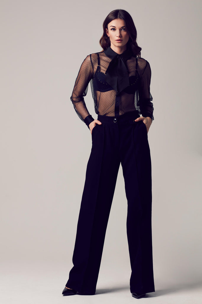 Nico black blouse bodysuit worn with wide leg trousers