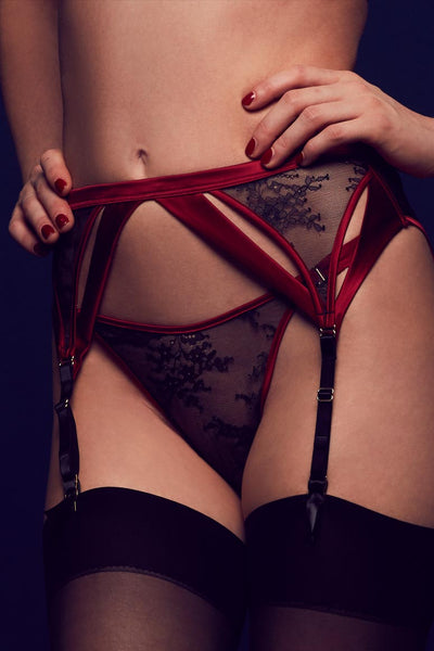 Odette luxury black lace thong worn with suspender belt in red satin and sheer lace