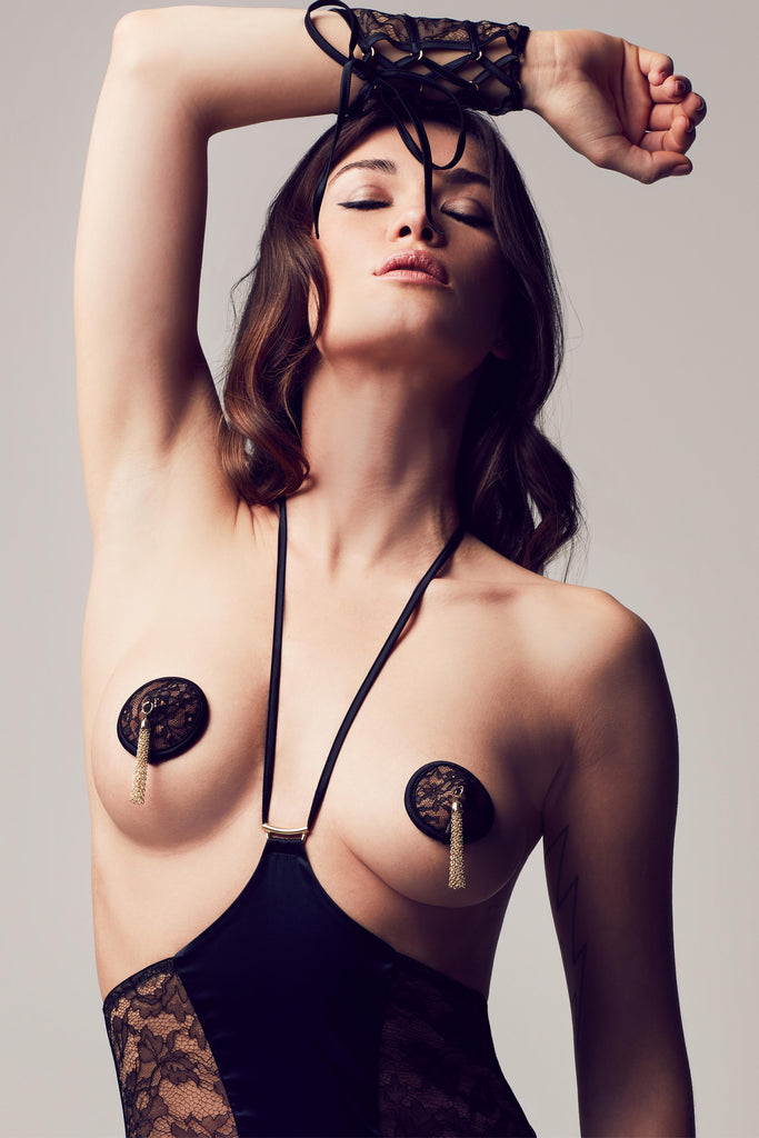 Luxury nipples pasties in black lace with gold chain tassel, part of Xena Black erotic designer lingerie collection