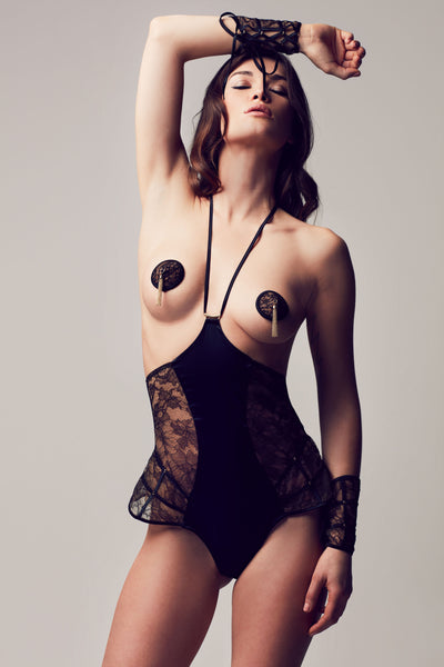 Erotic designer bodysuit with playsuit style and sheer black lace, part of Xena Black luxury lingerie collection