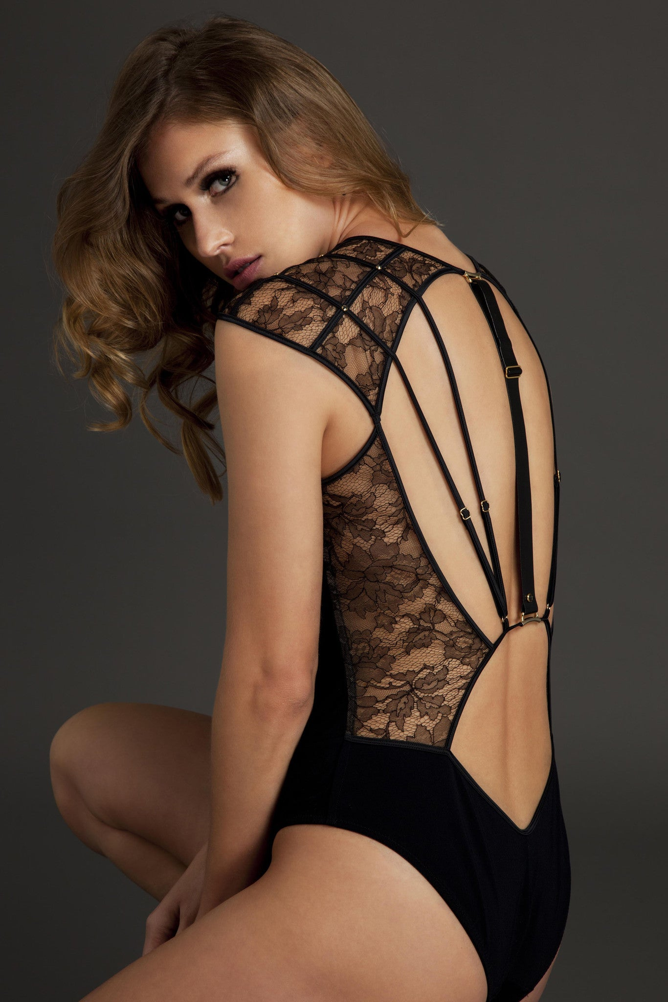 Xena Black designer bodysuit in black lace with luxury strapping back by Tatu Couture