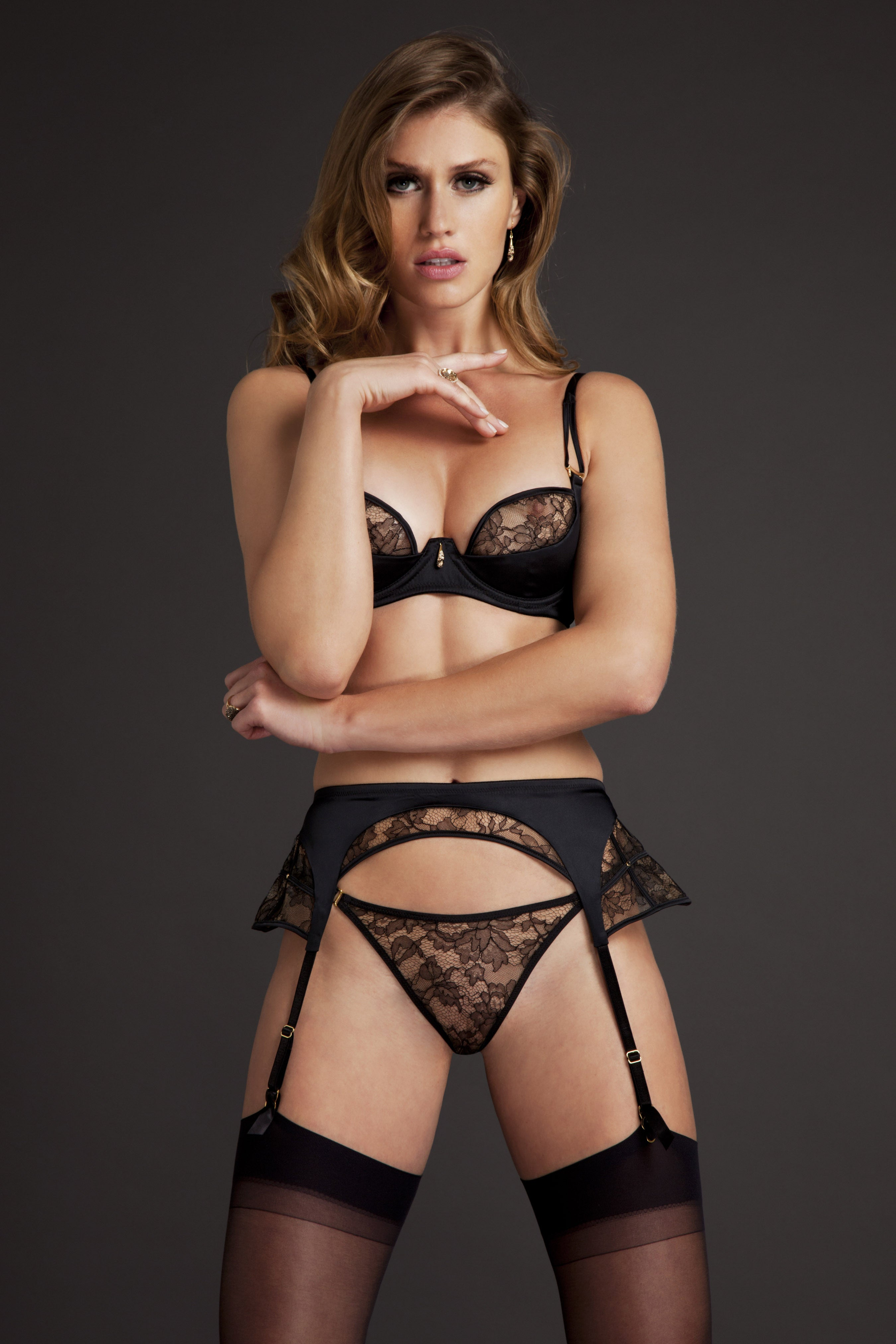 Luxury sheer black erotic lingerie set by Tatu Couture, with Xena Black plunge bra worn with sheer lace thong and suspender belt