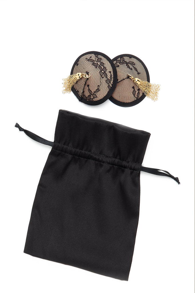 Luxury lingerie accessories featuring  black lace nipple pasties and gift bag
