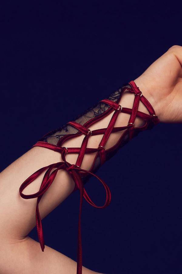 Red satin wrist ties on inside of Odette luxury sheer lace cuffs by Tatu Couture