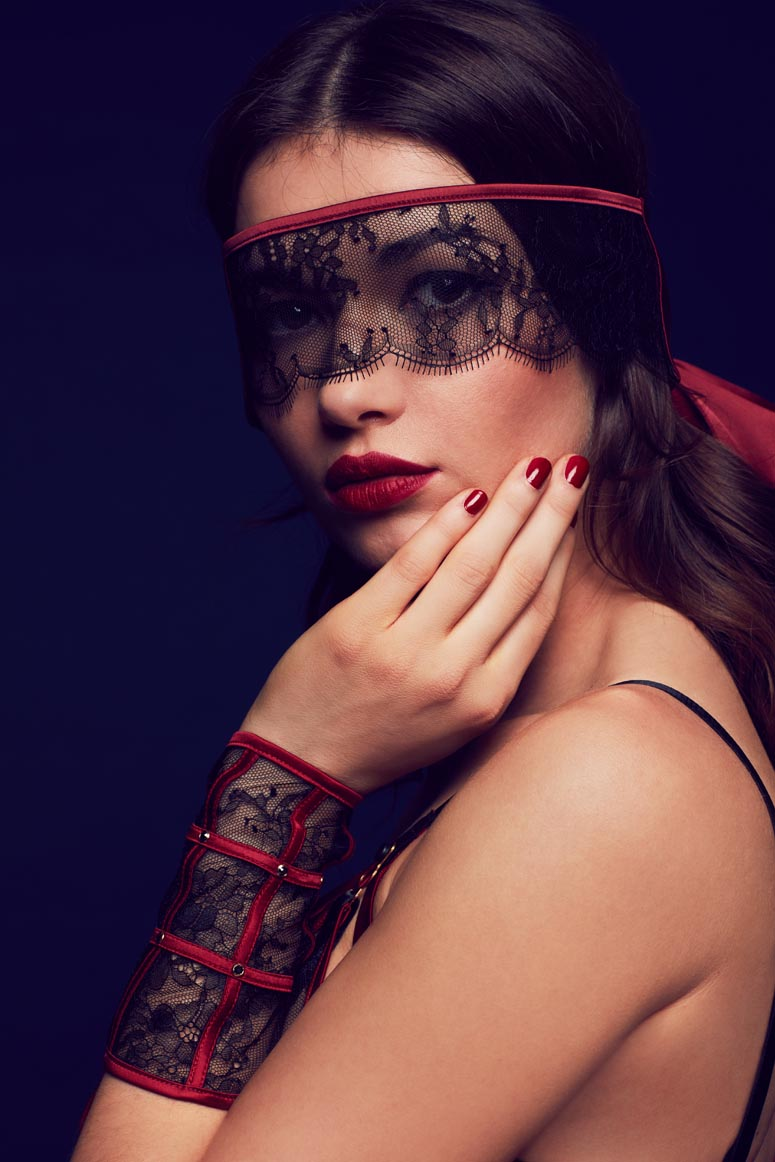 Luxury lace cuffs and blindfold with red satin trim, part of Odette designer seductive lingerie collection by Tatu Couture