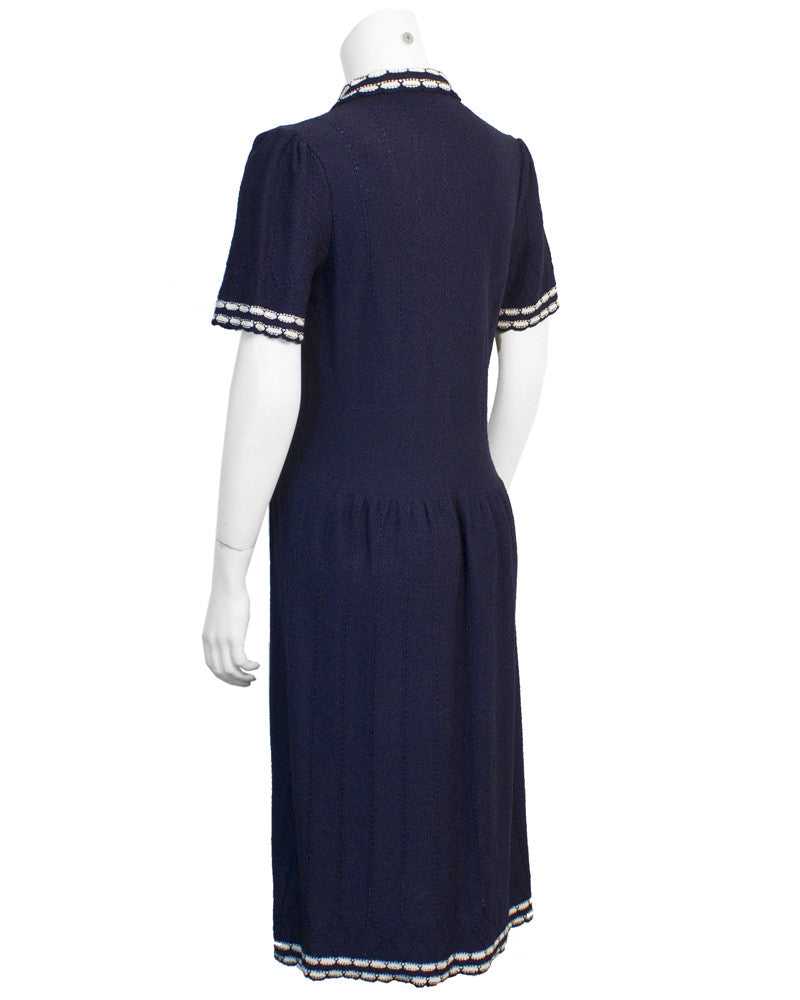 Navy knitted dress with white piping detail