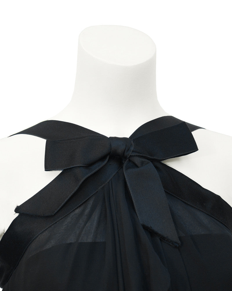Black cocktail dress with bow
