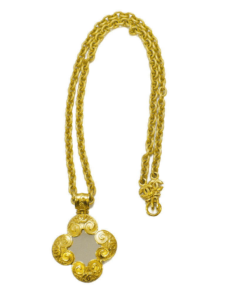 Goldtone chain with large mirror pendant