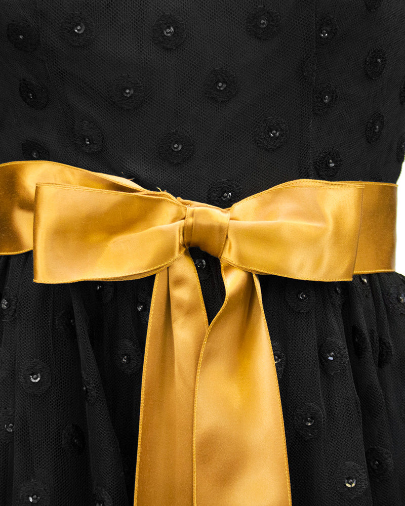 Black Long Sleeve Gown with Polka Dot Net Overlay and Gold Sash