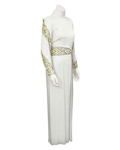 White gown with silver and gold beading