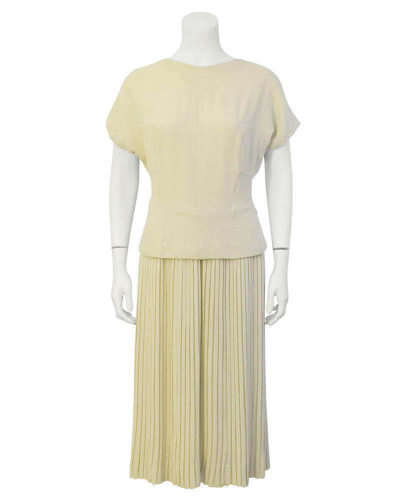 Cream Dress with Pleated Skirt and Bow Detail