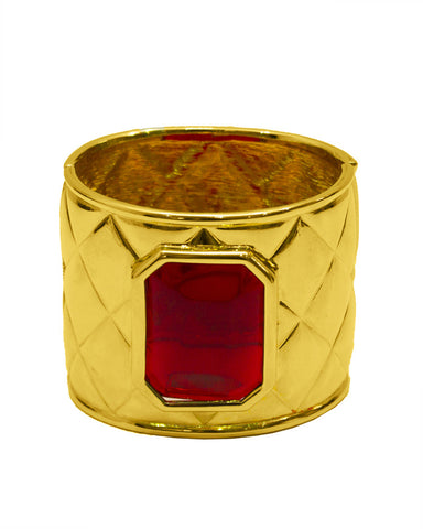 Gold quilted cuff with red poured glass stone