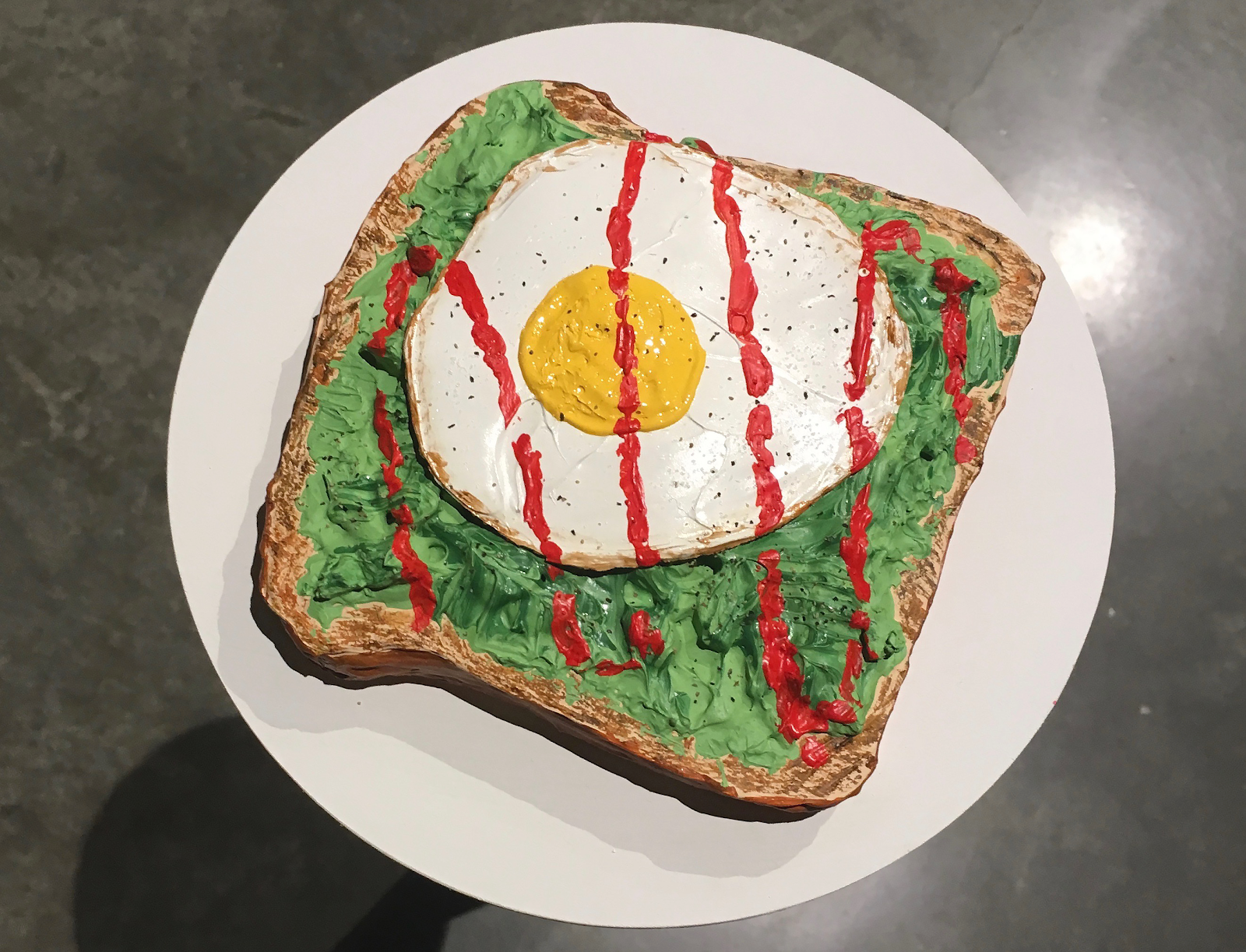 Avo toast with a sunny side up and hot sauce