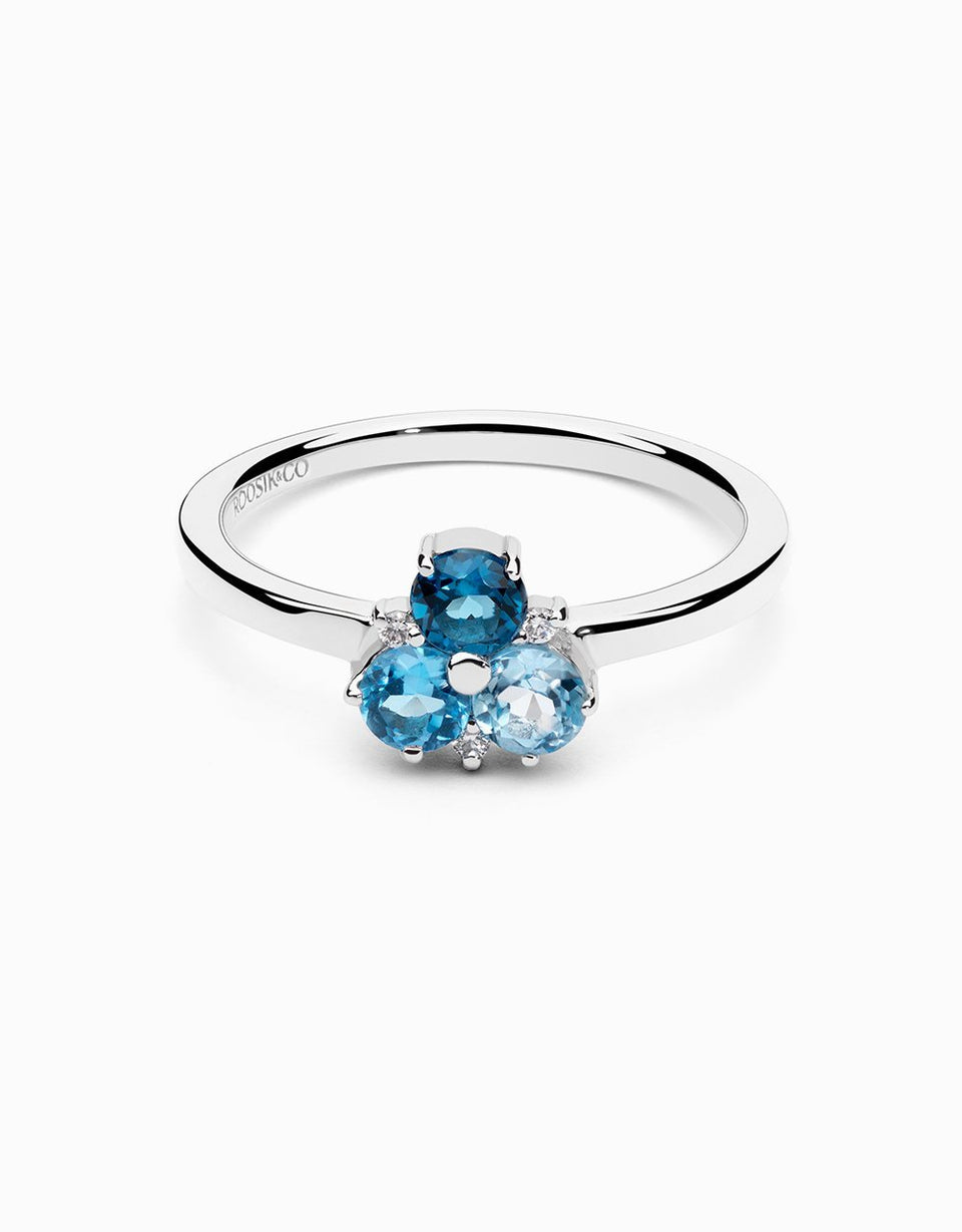 White gold ring with blue topaz and diamonds