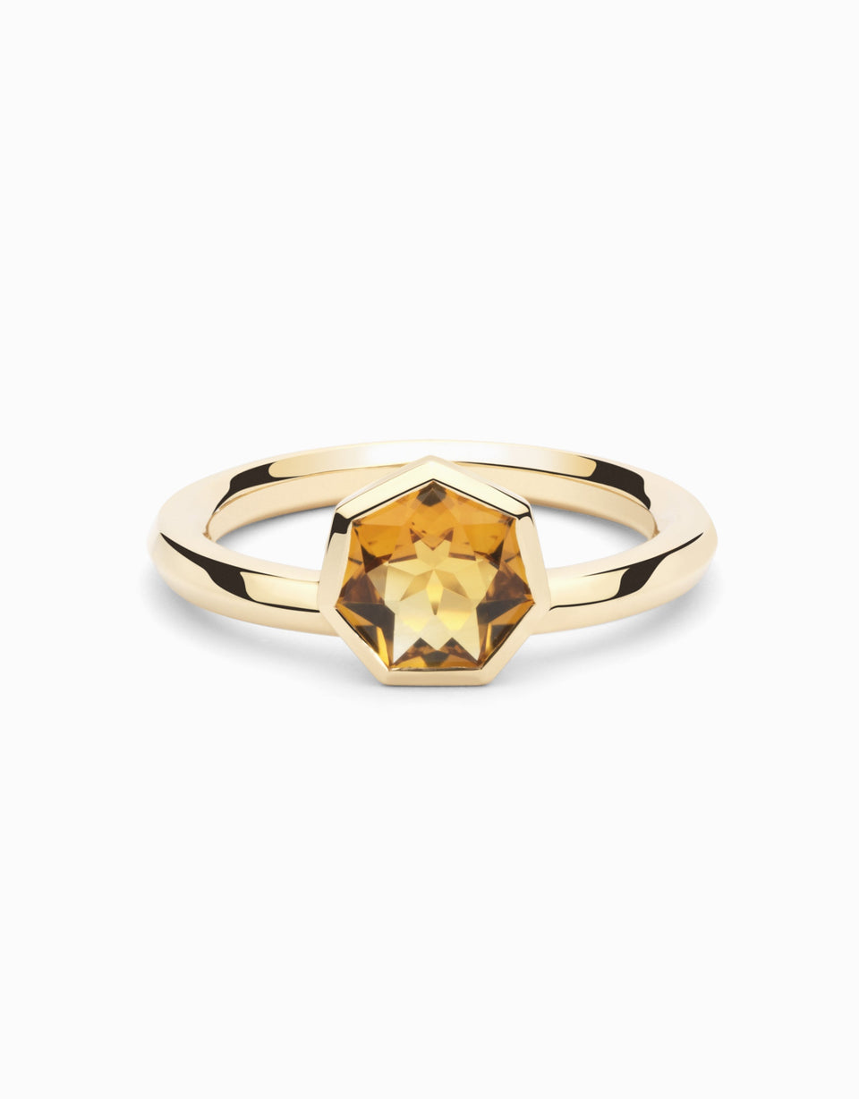 Gold ring with yellow gemstone