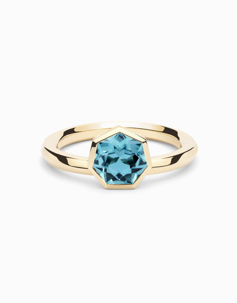 Gold ring with heptagonal blue topaz