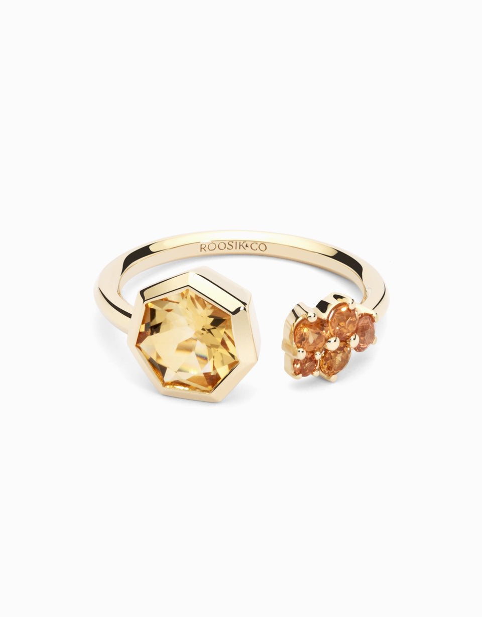 Gold ring with sapphires and heptagonal citrine