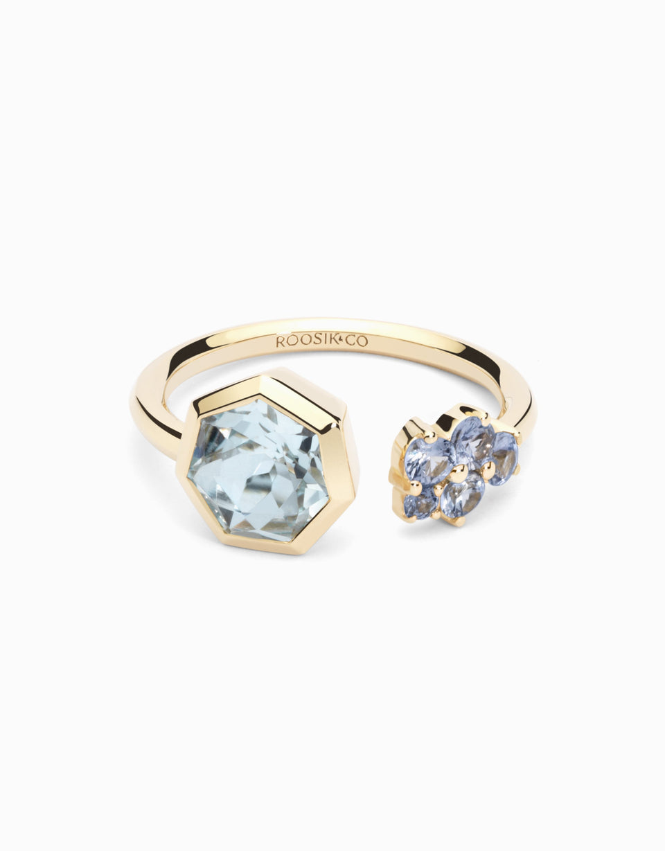Gold ring with sapphires and heptagonal topaz