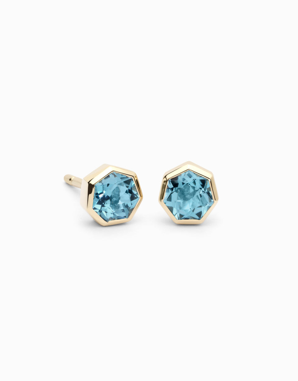 Gold earrings with heptagonal topaz