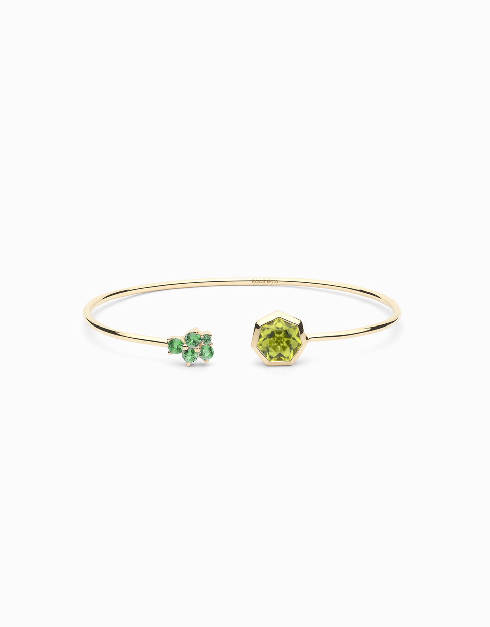 Gold bangle with tsavorites and heptagonal peridot
