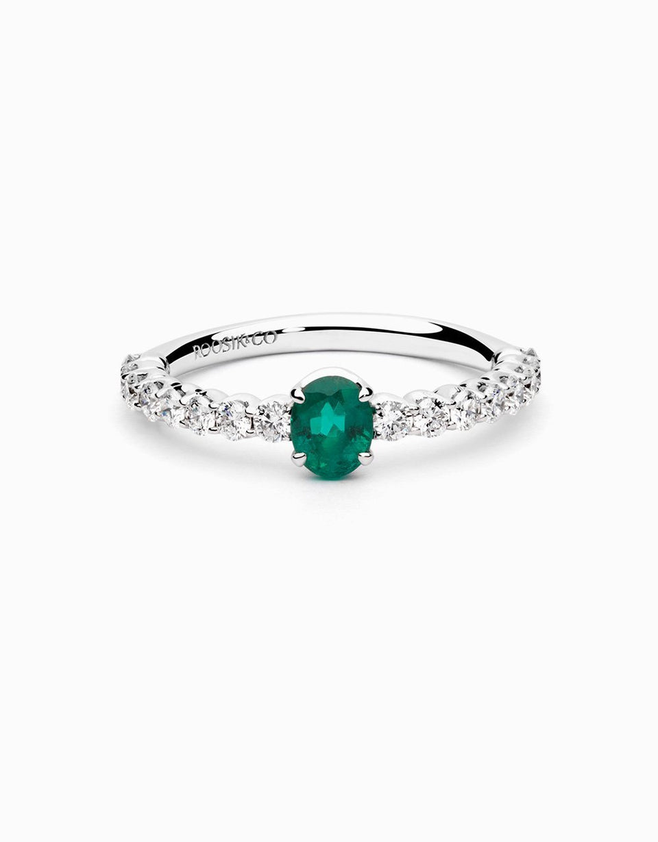 Emerald white gold engagement ring with diamonds