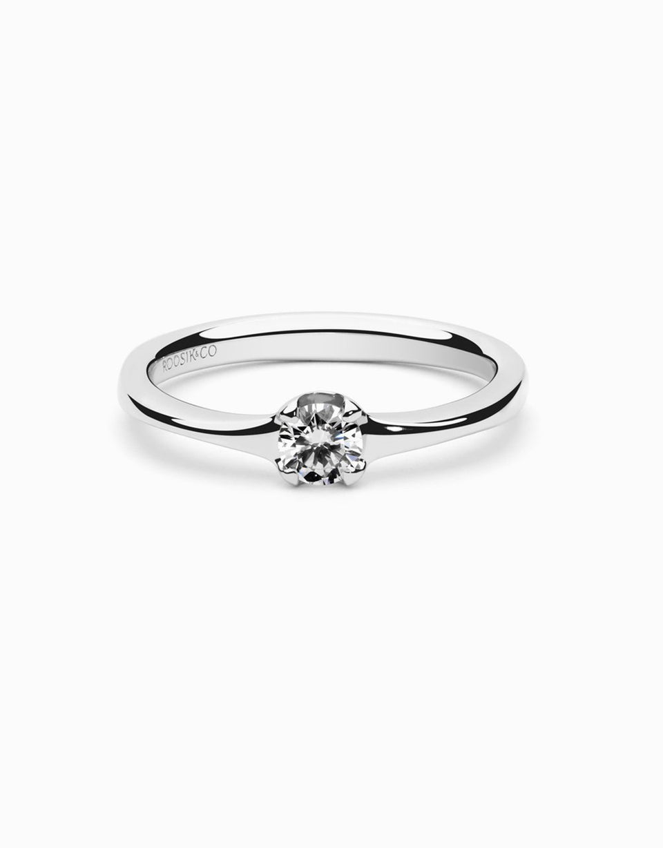 Handmade engagement ring, a solitaire ring with diamond and in white gold