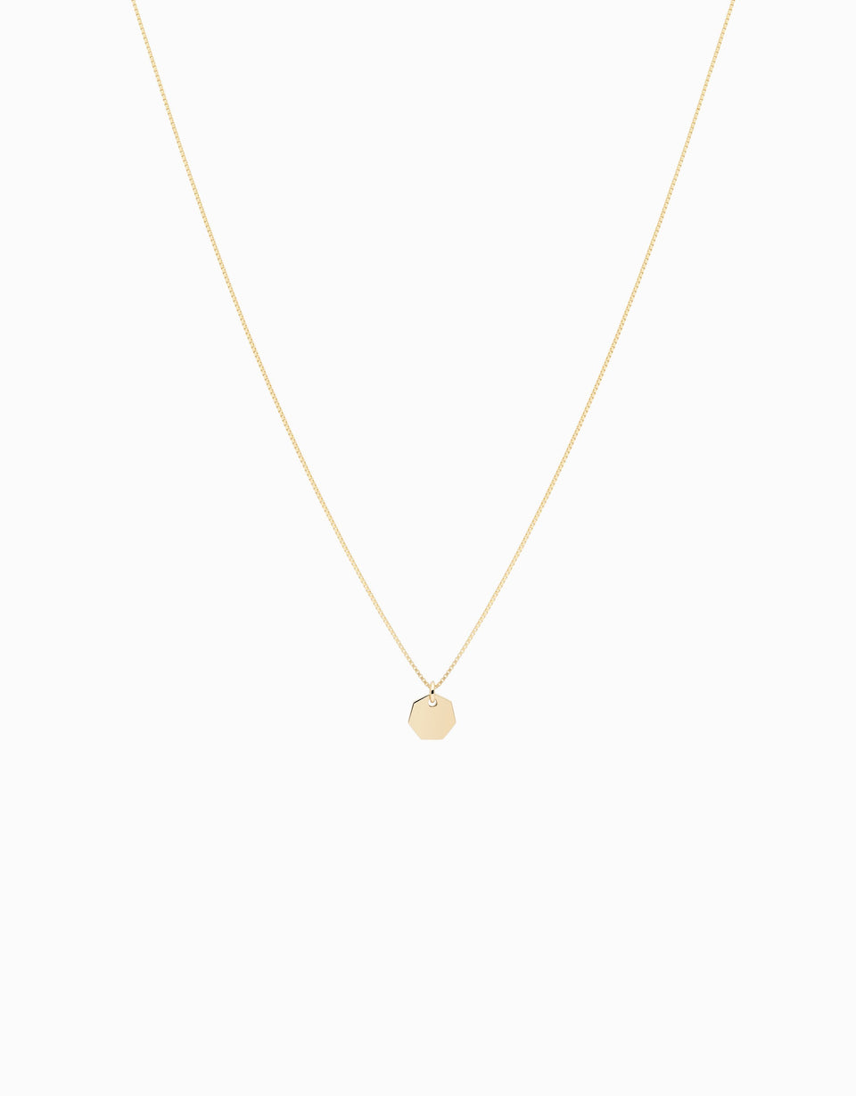 Little necklace in yellow gold, heptagon motif, minimal, handmade in Girona