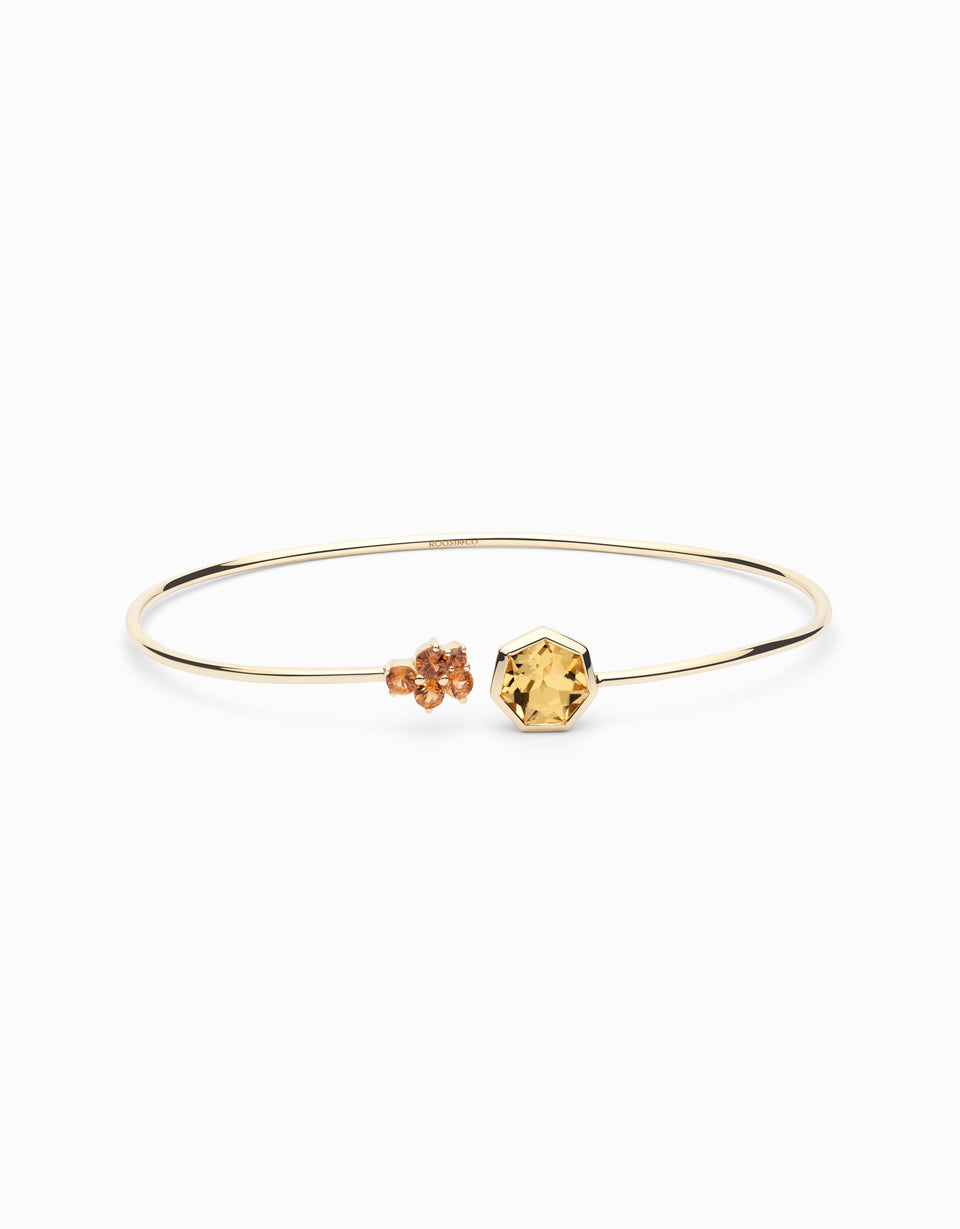 Gold bangle with sapphire and heptagonal citrine
